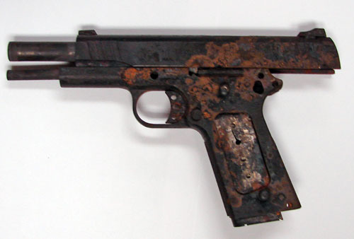 rusted pistol as a result of uncontrolled levels of moisture