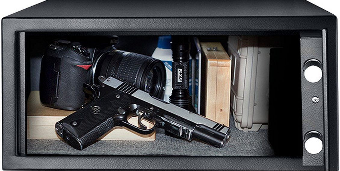 the BARSKA Biometric Safe packed with guns, ammo, and other items